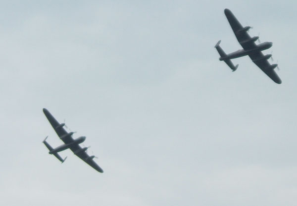 2 Lancasters flying together.